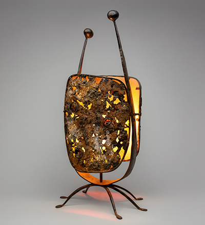 Lamp  c. 1964 C. Carl Jennings (1910–2003) forged steel, cast iron, glass, mica, parchment Collection of Forrest L. Merrill L2019.1501.016