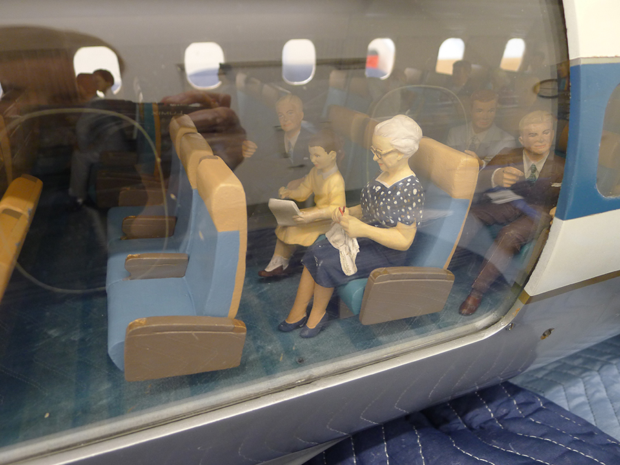 Conserving a Cutaway Model: United Air Lines Douglas DC-8 Middle section, before and after treatment (fills include one row of seats, seatback for knitting figure, arm and pad of paper for girl, and hand for male figure)