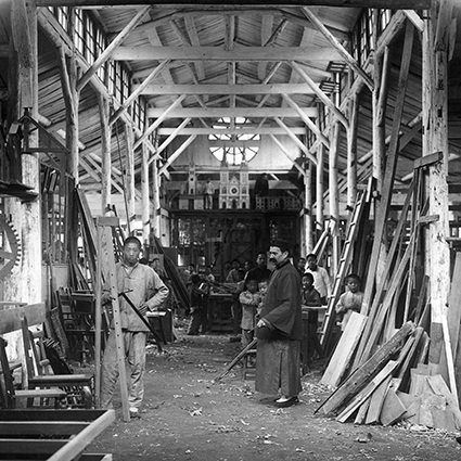 Interior of the Tushanwan carpentry workshop, with Brother Aloysius Beck at the center in the foreground