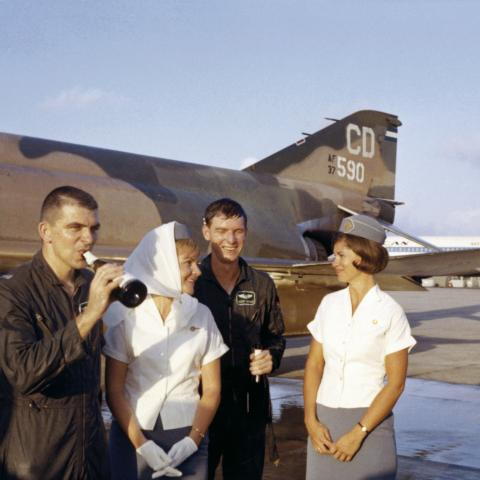 Flight attendant Mary Jo Hunt (left) and Pan American World Airways crew with fighter pilots, Da Nang AB, Vietnam