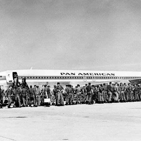 Soldiers waiting to board a Pan American World Airways Boeing 707