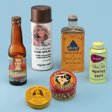 Farrah Fawcett hairspray and Jo-cur Waveset ; Beauty Brew beer shampoo and Helene Curtis spray net; Madam C. J. Walker's Wonderful Hair Grower; Lucky Brown Hair Dressing