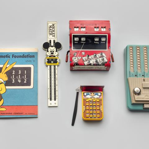 Children's arithmetic book and calculating devices  c. 1940s–70s