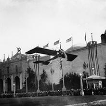 Lincoln Beachey waving to the crowd from his monoplane at the Panama-Pacific International Exposition, San Francisco March 14, 1915