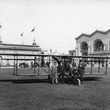 Art Smith with his mechanic (at far left) and two representatives from the Masters Spark Company at the Panama-Pacific International Exposition, San Francisco  1915