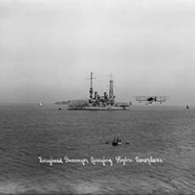 Loughead Brothers' Alco Hydro-Aeroplane Model G passing the battleship USS Oregon, San Francisco Bay 1915