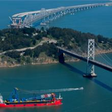 Crane barge steams into San Francisco Bay
