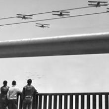 Airplanes flying over the Golden Gate Bridge during Opening Day Ceremonies