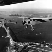 Cessna C-145 Airmaster near Fort Point on the south anchorage of the Golden Gate Bridge c. 1945