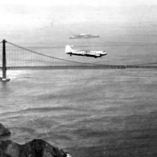 United Air Lines, Douglas DC-3 Mainliner flying over the San Francisco Bay c. 1945