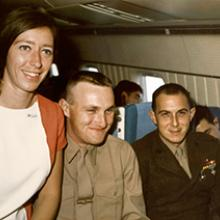 United Air Lines flight attendant Sandra Herrmann on board a MAC Charter Flight  c. 1968