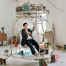 Zhang Dousan works in construction and works on Dousan No. 5 in his spare time—he has spent three years and more than $70,000 working on this coaxial-type helicopter 2015
