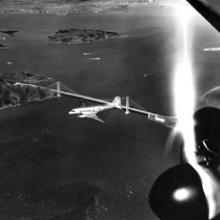 TWA (Trans World Airlines) Douglas DC-3 above the Golden Gate Bridge c. 1945