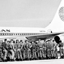 Soldiers waiting to board a Pan American World Airways Boeing 707  c. 1967