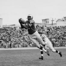 Wide receiver R. C. Owens makes a leaping catch during a preseason 24-17 victory over Washington at Kezar Stadium  August 16, 1959
