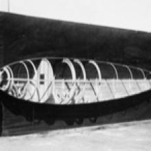 "Workers holding a half-skinned fuselage frame for a Loughead Model S-1, with ""Happy"" Hopkins at the tail, Santa Barbara, California  1919"