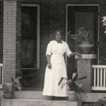 Madam C. J. Walker in front of her home and business