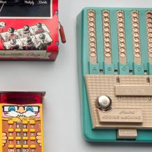 Arithmetic Foundation book and Arithmetic quiz  c. 1940s; Mickey Math and Toy adding Machine  c. 1960;  Little Professor  1976