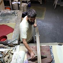 Artisans use the original antique printing blocks, which the French Ministry of Culture has designated as Historical Monuments; Zuber Factory, Rixheim, France