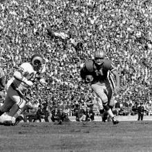 Quarterback Bobby Waters rushes from the shotgun formation for eleven yards during a 35-0 victory over the Los Angeles Rams at Kezar Stadium