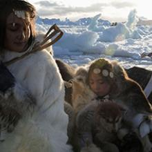 Mother and daughter with sled dogs in Uummannaq, Greenland  2009