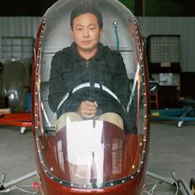 He Dongbiao sits inside his helicopter Low Altitude Free Man, which utilizes an MZ202 aeromotor. It took him one year to construct and flies as high as 1,300 feet 2015