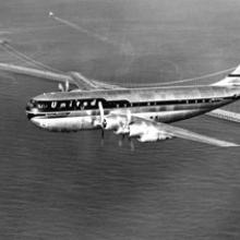 United Air Lines, Boeing 377 Stratocruiser above the Golden Gate Bridge c. 1955