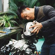 Wang Qiang refits the engine for his airplane in his backyard in Cixi, Zhejiang Province 2015