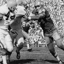 Linebacker Dave Wilcox prepares to tackle running back Leroy Kelly during the third quarter of a 34-31 victory over the Cleveland Browns at Kezar Stadium