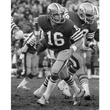 Quarterback Joe Montana rolls out to his right during a 17-10 victory over the New York Giants at Candlestick Park November 29, 1981