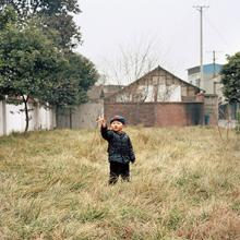 Wang Qiang's son plays with a toy airplane 2015