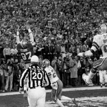 """""""The Catch"""": Wide receiver Dwight Clark reaches for a touchdown reception during the final minute of a 28-27 NFC Championship victory over the Dallas Cowboys at Candlestick Park January 10, 1982"""