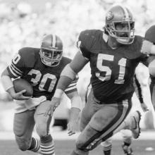 Running back Bill Ring (30) follows guard Randy Cross (51) during a 35-21 victory over the Tampa Bay Buccaneers at Candlestick Park December 4, 1983