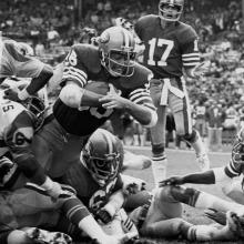 Running back Paul Hofer dives for a touchdown during a 20-26 loss to the Los Angeles Rams at Candlestick Park