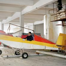 Jin Shaozhi shows off the Sky Horse, a fixed-wing aircraft with a steel frame, aluminum tubing, and a Rotax 447 motor 2015