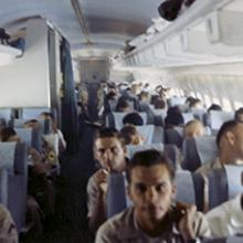 Military personnel aboard a Pan American World Airways R&R flight  c. 1968