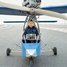 Wang Qiang sits inside the Wang Qiang No.2, a fixed-wing aircraft that uses a Yamaha engine from a boat. He spent approximately four months and $5,000 to construct the aircraft, which can reach an altitude of nearly 5,000 feet 2015