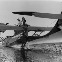 Consolidated PBY-5A Catalina seaplane is filled with fuel before a flight to Hawai'i