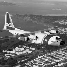 Lockheed HC-130H Hercules flies over the Golden Gate and the Veterans Administration Hospital  1976
